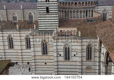 Italy Siena - December 26 2016: the detailed view from facciatone of Duomo di Siena or Metropolitan Cathedral of Santa Maria Assunta on December 26 2016 in Siena Tuscany Italy.