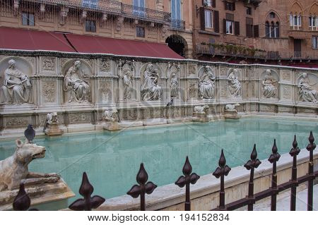 Italy Siena - December 26 2016: the view of Fonte Gaia or fountain of joyon Piazza del Campo on December 26 2016 in Siena Tuscany Italy.