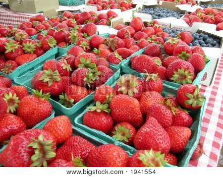 Strawberries And Blueberries At Market