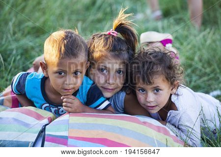 Cluj-Napoca, Romania - 27 June 2017:  Portrait of unidentified children living in the isolated Roma community in Pata Rat, the rubbish dump near Cluj-Napoca, Romania