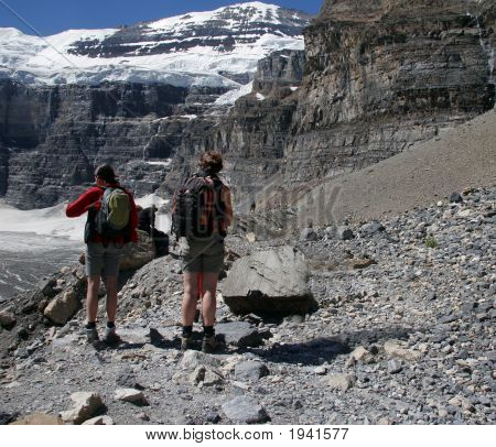 Hikers Look Out On Valley
