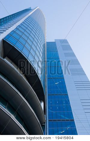 High-rise modern office building over blue sky