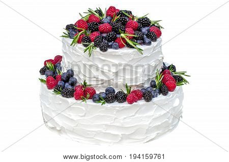 White two-tier cake with fruits isolated on white background
