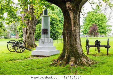 Gettysburg USA - May 24 2017: Gettysburg National Cemetery battlefield park with many grave stones and sites and cannons