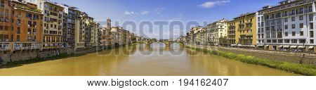 Panoramic view of Arno river and old bridge by day, Florence or Firenze, Italia