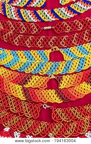 Macro closeup of red necklaces or bracelets made with traditional Ukrainian glass beads