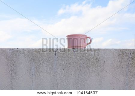 coffee cup pink plastic on the floor with blue sky background