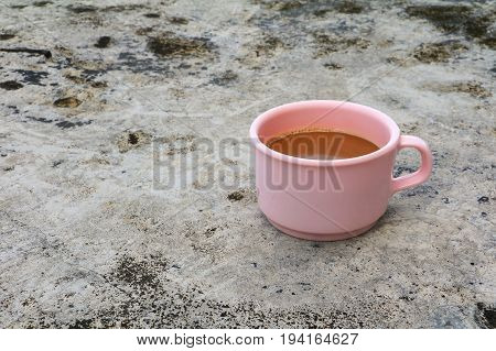 coffee cup pink plastic on the Cement floor old with copy space