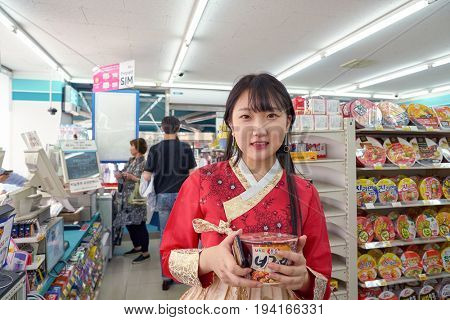 SEOUL, SOUTH KOREA - CIRCA MAY, 2017: woman at GS25 convenience store in Seoul. GS25 is a convenience store brand in South Korea.