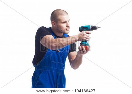 A young man with a short haircut is going to work with a green screwdriver on an isolated background. Building