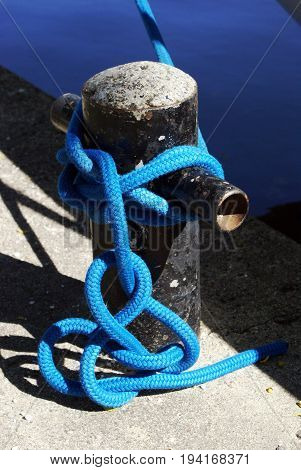 Closeup view of a tied boating knot used to hold the ship at shore.