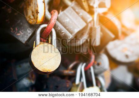 Background with locks. Metal bridge with lots of locks. Small locks