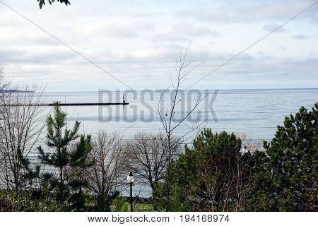 A view of Lake Michigan, the Petoskey waterfront, the breakwater, and the Pierhead Lighthouse, as seen from Sunset Park in Petoskey, Michigan.