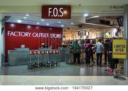 Kota Kinabalu,Sabah-June 17,2017:View of Factory Outlet Store FOS in Suria shopping complex in Kota Kinabalu,Sabah.Its provides value,quality & fashionable men's, ladies' & kids' clothing at affordable prices in Malaysia.