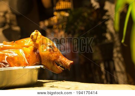 Photograph of a cooked piglet ready to be eaten