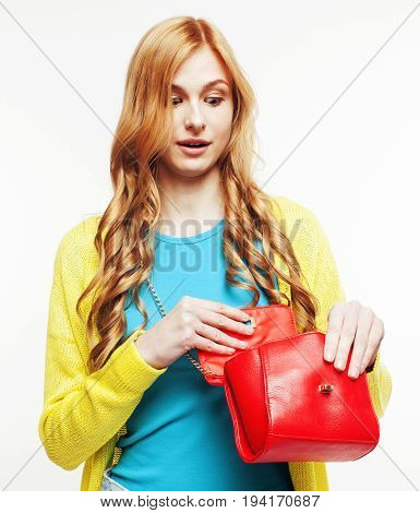 young pretty woman with little cute handbag posing cheerful smiling isolated on white background, lifestyle sale people concept close up