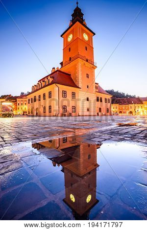 Brasov Transylvania Romania - Twilight image with water reflection of Council House medieval downtown.