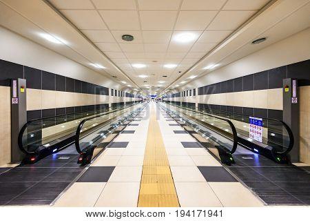 BARI ITALY - JULY 09 2015: Moving escalator conveyor at Karol Wojtyla Airport in Bari.