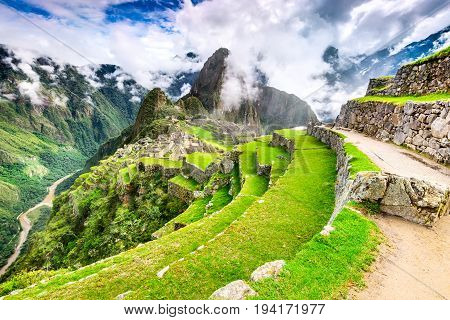 Machu Picchu Peru - Ruins of Inca Empire city and Huaynapicchu Mountain Sacred Valley Cusco. Amazing place of South America.