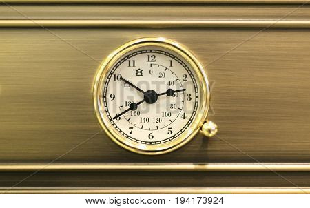 Watch and thermometer on the stove top for cooking control.