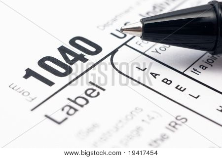 Filling in american individual tax form 1040 by ball-pen