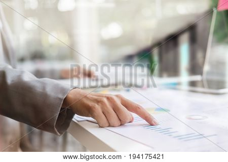 business man financial inspector and secretary making report calculating or checking balance. Internal Revenue Service inspector checking document. Audit concept at working