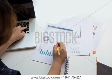 business man financial inspector and secretary making report calculating or checking balance. Internal Revenue Service inspector checking document. Audit concept at working with plan on office desk