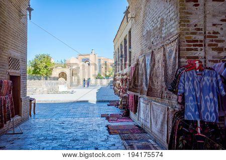BUKHARA UZBEKISTAN - SEPTEMBER 4: Traditonal uzbek carpets for sale on the street in downtown of Bukhara. September 2016