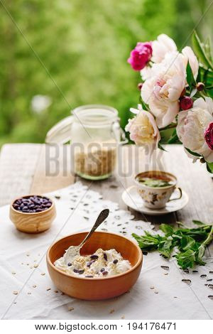 healthy and tasty breakfast with honeysuckle berries and tea