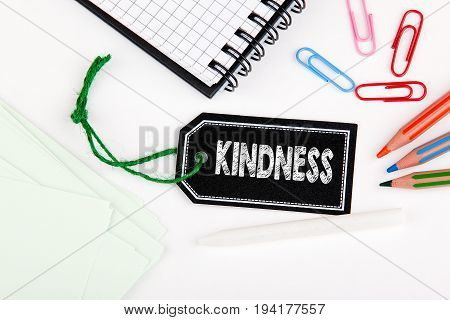 Kindness. Price tag with string on a white background.