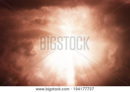 Dramatic apocalyptic clouds background with light rays