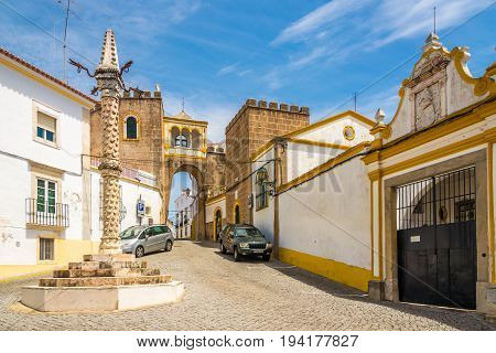 ELVAS,PORTUGAL - MAY 16,2017 - Pillory and Arch of Santa Clara in Elvas city . Elvas is a Portuguese municipality former episcopal city and frontier fortress of easternmost central Portugal.