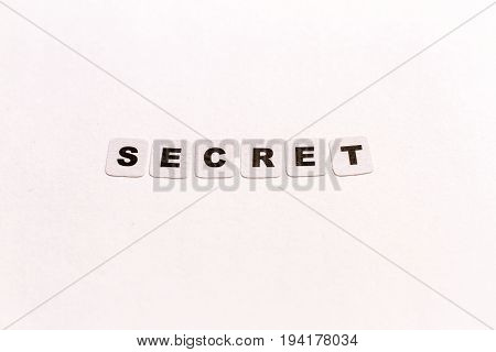 Secret word written in black letters on neutral background