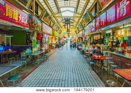 TAIPEI TAIWAN - JUNE 07: This is the Huaxi street market which is a popular night market in Taipei where many people come to try different foods and go shopping on June 07 2017 in Taipei