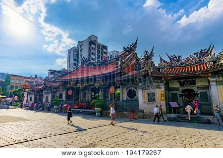 TAIPEI TAIWAN - JUNE 07: This the exterior architecture of Longshan temple a popular buddhist temple where many local Taiwanese and tourists often visit on June 07 2017 in Taipei