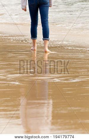 Solitary Person Walking - Wading In Incoming Waves