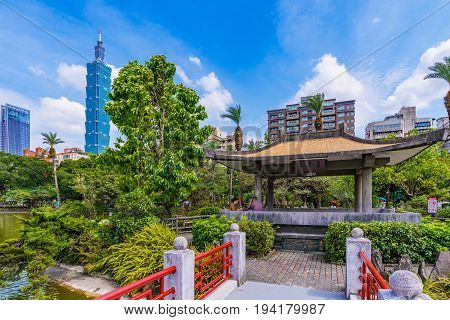 TAIPEI TAIWAN - MAY 31: This is a scenic view of Taipei 101 with a traditional chinese pavilion and nature in the Sun Yat-sen memorial hall park on May 31 2017 in Taipei