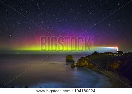 The Lights of Aurora Australis Behind Airey's Inlet Lighthouse
