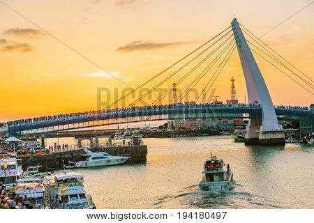 TAIPEI TAIWAN - MAY 29: This is a view of lover's bridge in fisherman's wharf it is a famous bridge where couples come to view the sunset in the Tamsui area on May 29 2017 in Taipei