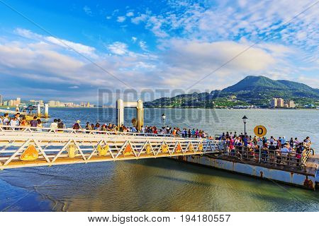 TAIPEI TAIWAN - MAY 29: Tourist's waiting on a pier for a tourboat which wiill take them to Fisherman's wharf a famous landmark in Tamsui on May 29 2017 in Taipei