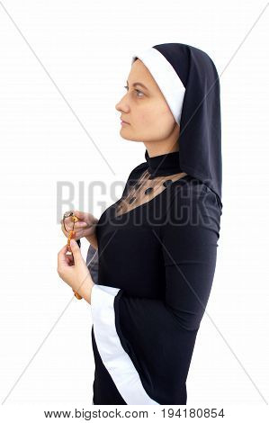 A young nun with rosary on a white background
