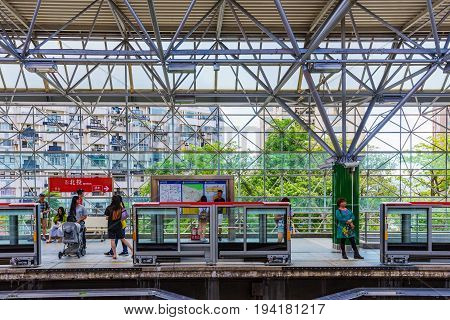 TAIPEI TAIWAN - MAY 29: Passengers waiting for the train to arrive at Beitou MRT station which is a popular MRT station fro travellers in Taipei on May 29 2017 in Taipei