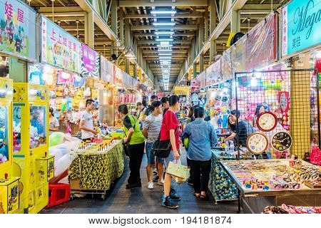 TAIPEI TAIWAN - MAY 20: This is a games street in Shilin night market where many people come to play games and win prizes on May 20 2017 in Taipei