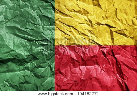 Benin flag painted on crumpled paper background