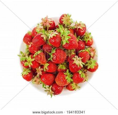 Ripe organic strawberry in tureen with green leaves and flower isolated on white background.