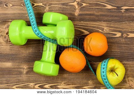 Weight Dumbbells With Measuring Tape, Apple, Orange, Diet Concept