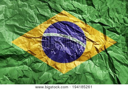 Brasil flag painted on crumpled paper background
