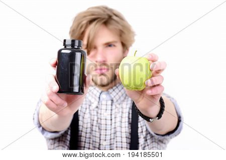 Man With Beard And Stylish Hairdo Holds Apple And Pills