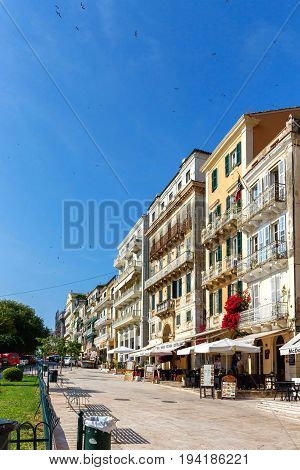 CORFU ISLAND, GREECE - JUNE 26, 2017: Corfu island streets for tourists with restaurants and hotels