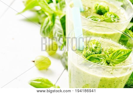 Healthy Basil broccoli frisee lettuce smoothie closeup